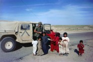Major MacLean Handing Out Food to Children in Kuwait