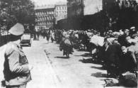 Sicherheitsdienst [SD] (Security Service) Officer Supervises Movement of Ghetto Jews