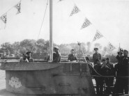 U-boat returning from patrol with vistory pennants for ships sunk.